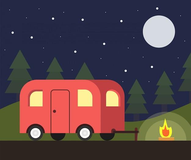 Camper trailer y escena de campamento en la noche