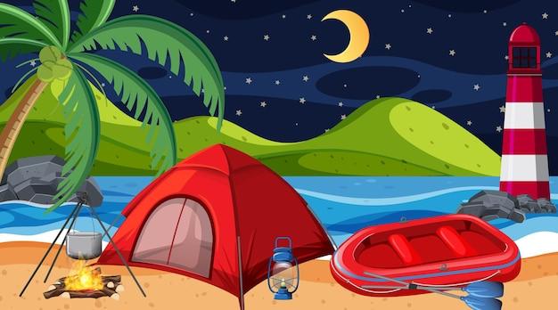 Camping o picnic en la escena nocturna de la playa.