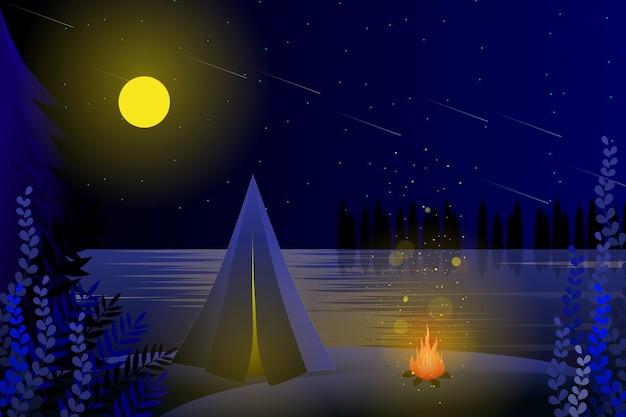 Camping de verano con fondo de cielo estrellado.