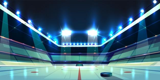 Campo de hockey, pista de hielo con disco de goma negro. estadio deportivo con focos.