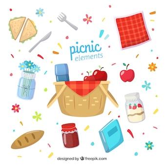 Canasta dibujada a mano y elementos de picnic