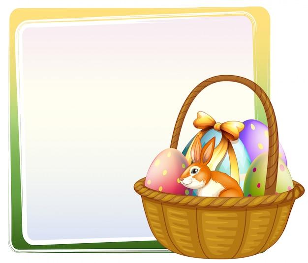 Una canasta de huevos de pascua con un conejito