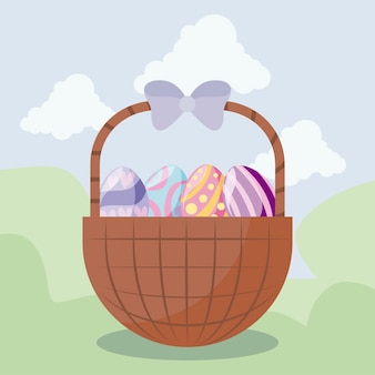 Canasta con huevos de pascua en paisaje.