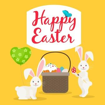 Canasta de pascua y tarjeta de felicitación de conejos.