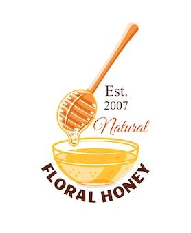 Capacidad de vidrio y cuchara con gotas de miel aislado sobre fondo blanco.