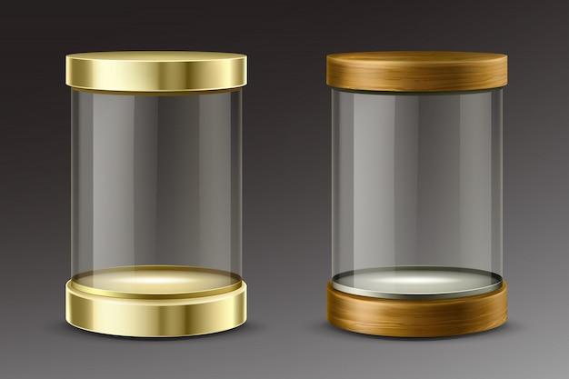 Cápsulas de vidrio con tapas doradas y de madera.