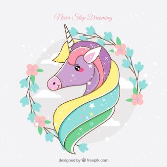 Cara adorable de unicornio dibujada a mano