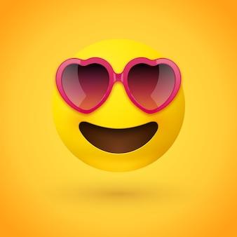 Cara de emoji con gafas de sol rosas en forma de corazón