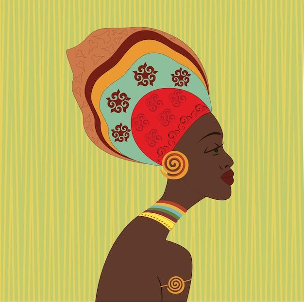 Cara de mujer étnica africana. vista de perfil joven atractiva de la tribu con turbante colorido