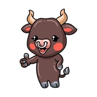 Caricatura lindo bebé toro dando pulgar