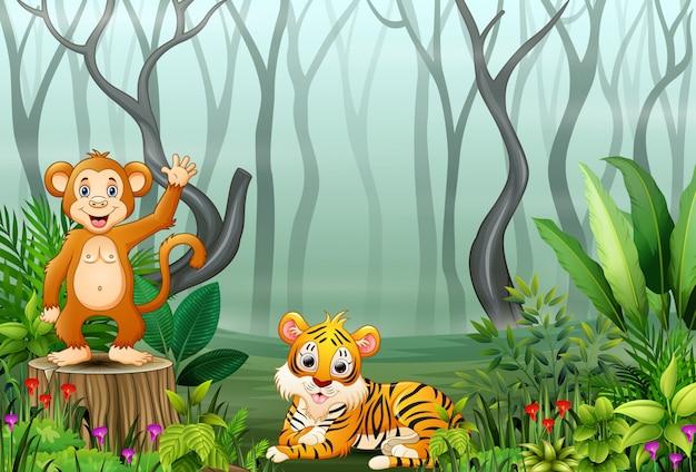 Caricatura de mono y tigre en el bosque de niebla.