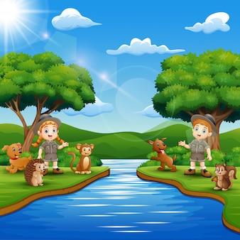 Caricatura de zookeeper niño y niña con animal por el río