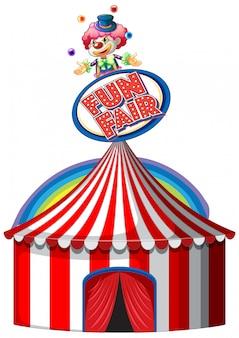 Carpa de circo con cartel en la parte superior y arco iris en segundo plano.