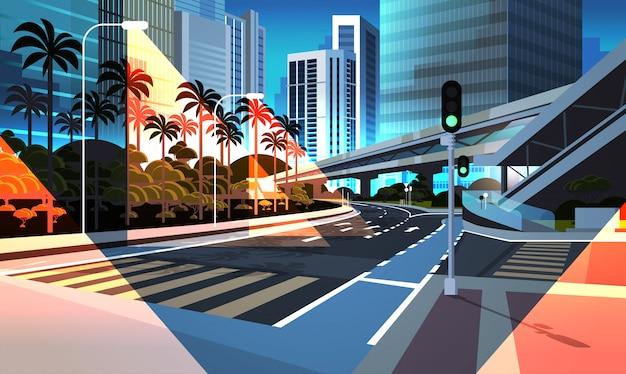 Carretera carretera noche ciudad calle con modernos rascacielos