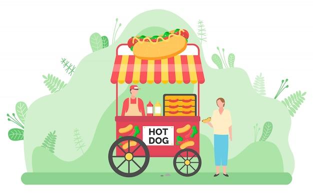 Carrito de comida callejera con perritos calientes