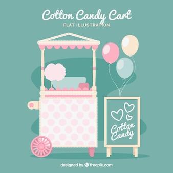 Carro de algodón de azúcar y globos con colores suaves