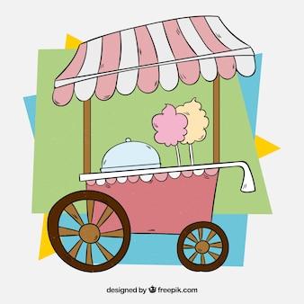 Carro de algodón de azúcar rosa con fondo colorido