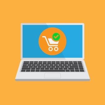 Carro de compras en la pantalla de un portátil. las compras en línea.