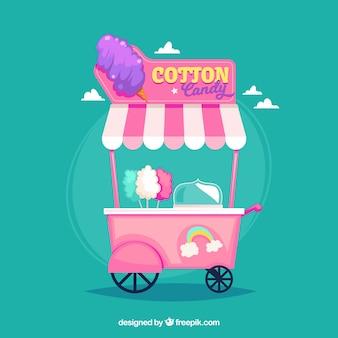 Carro rosa de algodón de azúcar con arcoiris
