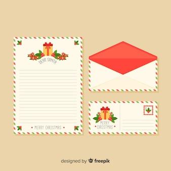 Carta y sobre navideños con regalos
