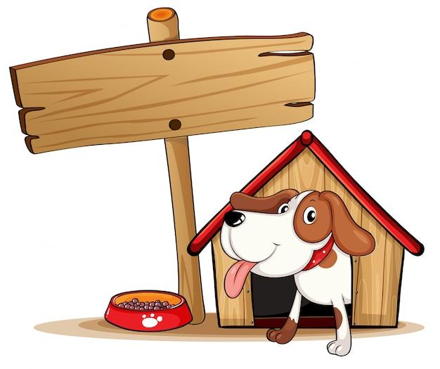 Un cartel al lado de una caseta de perro.