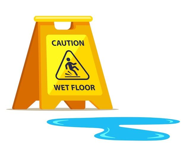 Cartel amarillo con cuidado mojar el suelo y charco cercano.