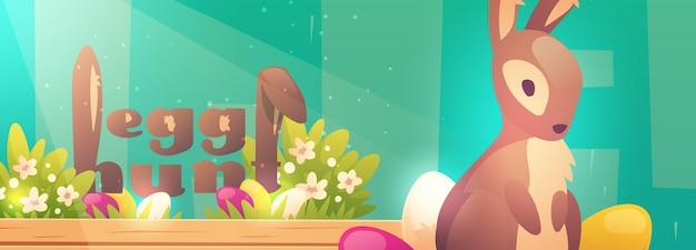 Cartel de búsqueda de huevos de pascua con conejito y flores.