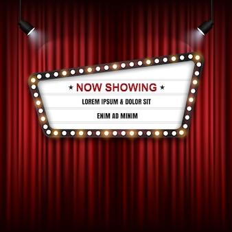 Cartel de cine teatro en la cortina roja