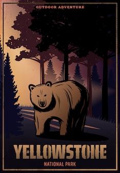 Cartel de color vintage del parque nacional de yellowstone con inscripción y oso sobre paisaje forestal