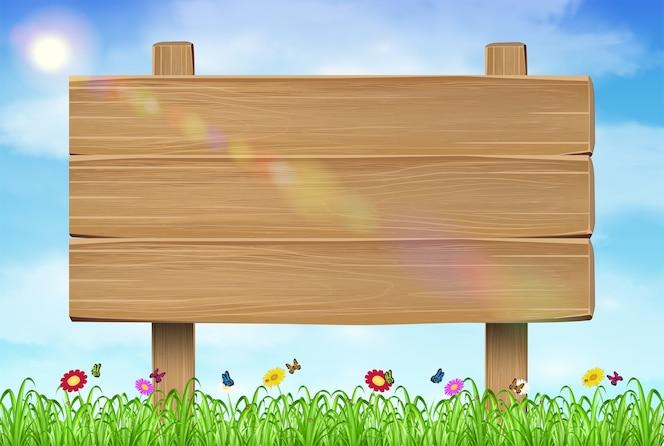 Cartel de tablero de madera en hierba