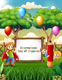 Cartel del día internacional de la felicidad con niños alegres en la naturaleza