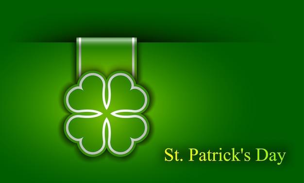 Cartel del día de san patricio. una hoja de trébol y una inscripción de saludo en colores verdes.