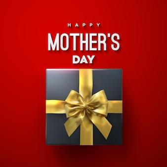 Cartel de feliz día de las madres con lazo de oro caja de regalo negro