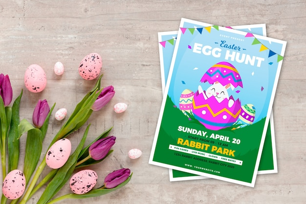 Cartel de fiesta de caza de huevos de pascua con tulipanes