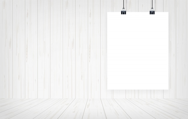 Cartel del libro blanco que cuelga con el fondo de madera de la pared.