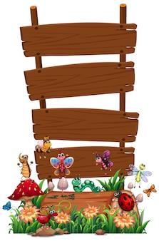 Cartel de madera en blanco con conjunto de jardín de animales aislado