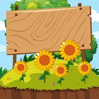 Cartel de madera en el jardín de girasol