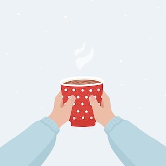 Cartel de navidad con dos manos sosteniendo una taza de bebida caliente.