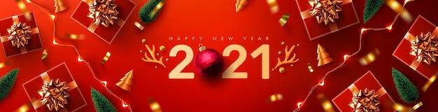 Cartel o pancarta de promoción de año nuevo 2021 con caja de regalo roja, elemento navideño y luces led de cadena