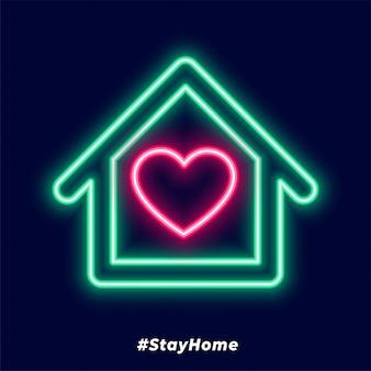 Cartel de quedarse en casa con casa de neón y corazón