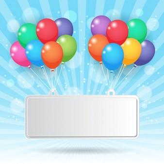 Cartel sujetado con globos de colores