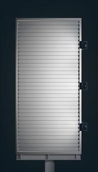 Cartelera vertical de publicidad en blanco en columna metálica con proyectores sobre fondo oscuro aislado
