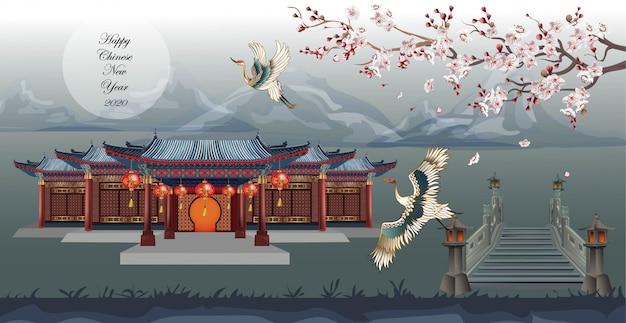 Casa china con pájaro grúa y hermosos ciruelos que cruzan el puente en la montaña