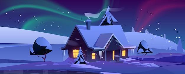 Casa con decoración navideña por la noche en paisaje invernal