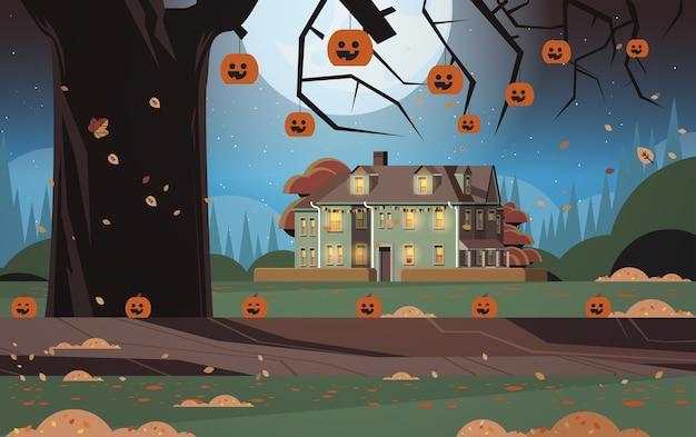Casa decorada para la celebración de las fiestas de halloween vista frontal de la construcción de viviendas con fondo de paisaje nocturno de calabazas
