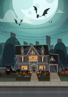 Casa decorada para halloween, vista frontal con diferentes calabazas