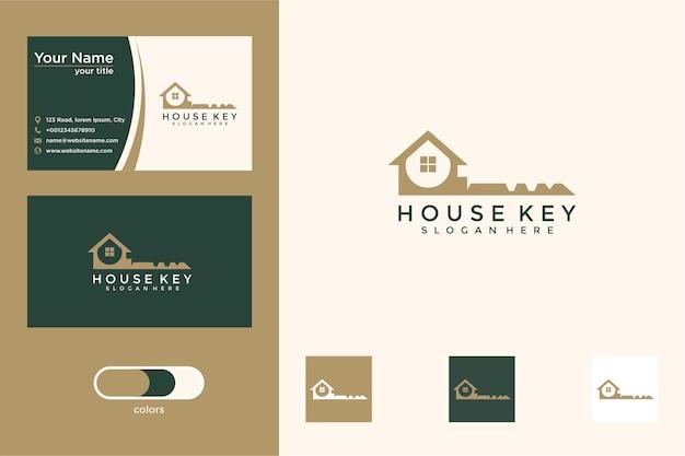 Casa con diseño de logotipo clave y tarjeta de visita.