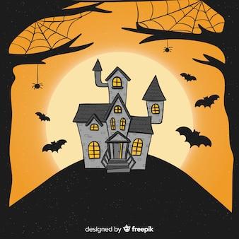 Casa embrujada de halloween con murciélagos