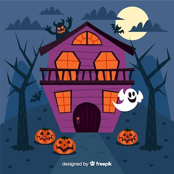 Casa embrujada de halloween plana con calabazas