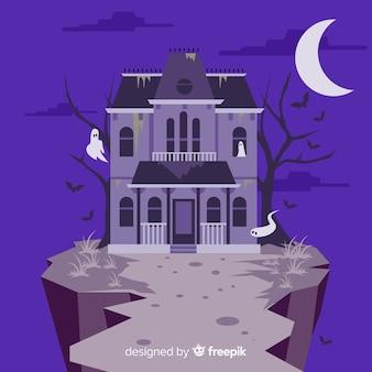 Casa encantada de halloween terrorífica con diseño plano